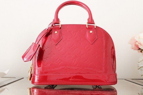 Louis Vuitton Alma BB - it comes with a shoulder strap so you can wear it 3 ways!