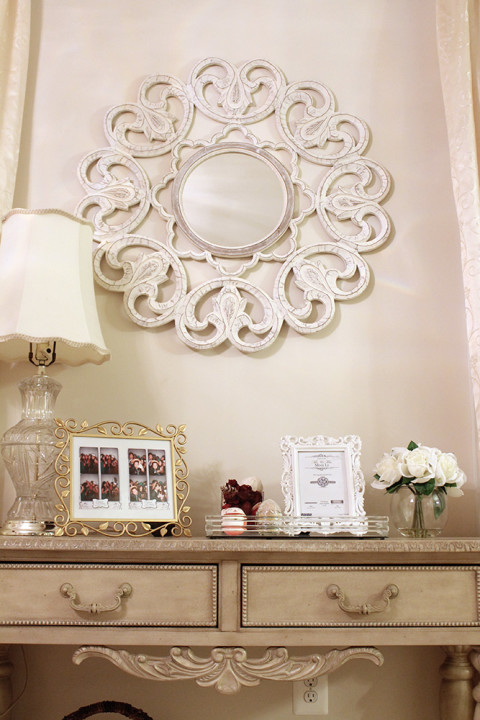 an ornate mirror adds glam to any room